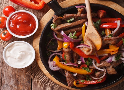 39556605 - delicious fajitas on a table in a rustic style. vertical close-up view from above